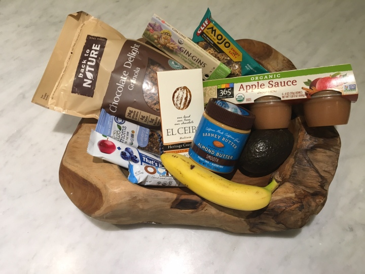 Foods in photo include: 1. Back to Nature- Chocolate Delight Granola 2. Two Moms in the Raw- Blueberry 3. That's It- Apple and Blueberry 4. Ocho- coconut 5. El Ceibo 6. Gin-Gins Arjuna Ginger Bar 7. Barney Butter- Almond Butter 8. Mojo Trail Mix bar 9. Cinnamon Apple Sauce 10. Banana 11. Avocado