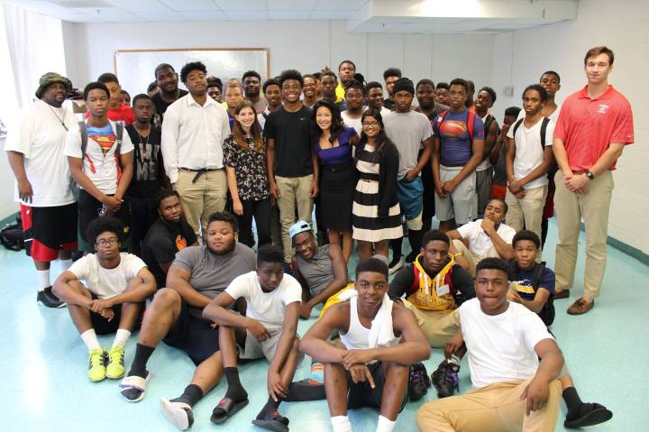Becky with Football players from Friendship Collegiate Academy in our Men of Code Program